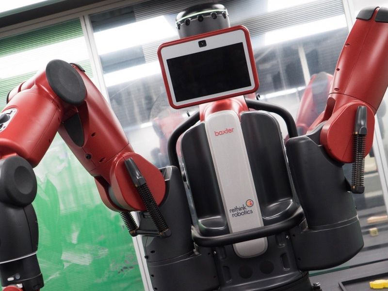 "A manufacturing robot with two ""arms"" and a central screen."